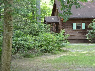 RIVERFRONT !  HOT TUB !  Log Cabin. TOP RATED !  Fully staffed w/mgr on premise