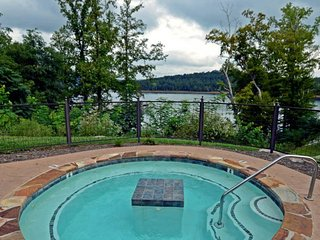 High-end condo in lakefront building with shared pool, hot tub, dock