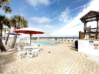 NEW LISTING! Beach-themed studio with 2 shared pools, right on the beach!