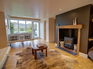 Sitting areas with log burner, extra tv and views