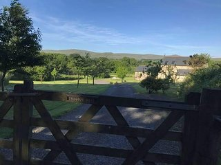 View from the entrance gate to Swallow Barn and Dartmoor beyond
