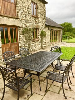 Alfresco dining at the rear of Swallow Barn