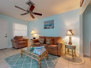 NEW LISTING! Breezy condo w/shared pool -minutes from beach & dining