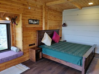 Bed & breakfast at Ramgarh Nainital, Uttrakhand- Wooden chalet lower East room