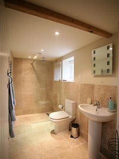 Bathroom with walk in natural stone shower