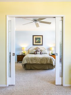 Sliding doors separate the bedroom from the living area
