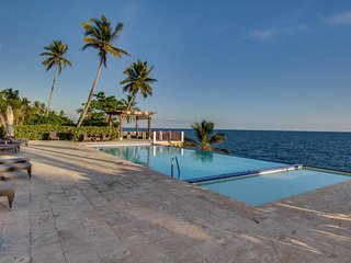 Dog-friendly apartment w/ views, large deck & shared pool - steps to beach!