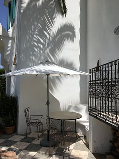 Outdoor eating under the palm.