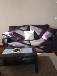 sofá pata tres personas