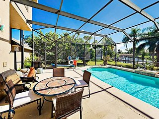 Stylish 3BR Home on the Canal with Private Screened Pool, Spa & Dock