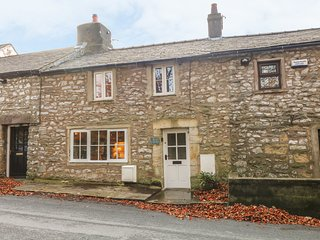 2 STORRS COTTAGES, south-facing patio, in Ingleton