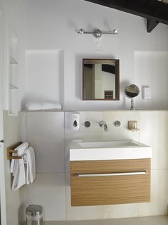 bathroom with walk in shower with rain forest head, toilet and sink