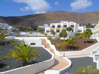 Spacious apartment a short walk away (57 m) from the 'Playa Giniginamar' in Gini