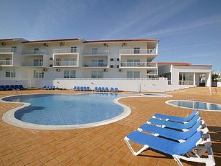 Holiday home with private garden and communal pool close to beach