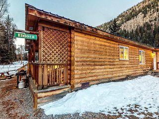 NEW LISTING! Cozy waterfront cabin w/mountain view, wood stove & hot tub