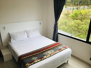 Modern 1BR Apartment on the River & Eco Trail