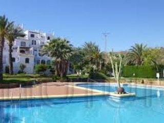 Spacious 2 bedroom app. Private gardens, large swimming pool, close to the beach