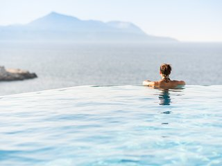 A secluded cove and a slice of luxury- Dive into the heated infinity pool