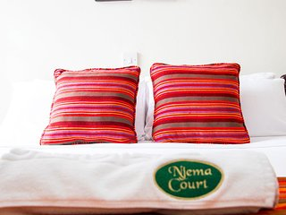 Njema Court Apartments - One Bedroom Apartment 1