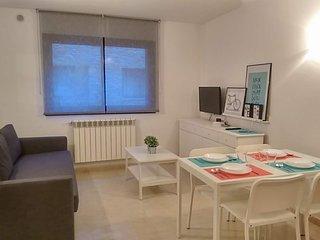 Bonito apartamento cerca de pistas WiFi gratuito, parking y terraza con vistas