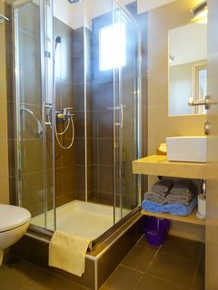 Bathroom: Free toiletries Korres, slippers and beach towels are available.