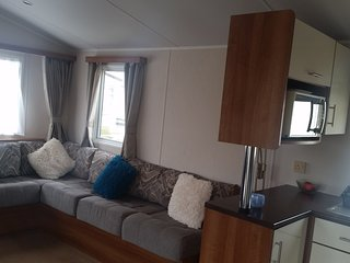 Modern 2 bedroom caravan with private parking and south facing decking.