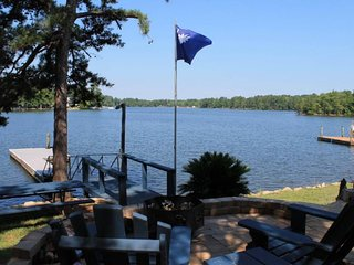 NEW LISTING! Lakefront, dog-friendly home with a dock and a wrap-around deck!