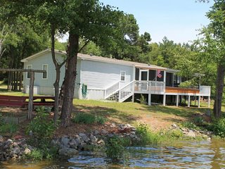 NEW LISTING! Lakefront home on .75 acre and 200 feet of waterfront with dock!