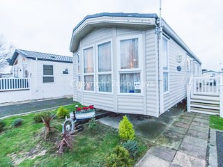8 berth caravan with decking, D/G and C/H. At Naze Marine Holiday Park. 17045SL