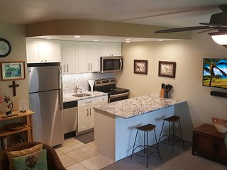 Newly renovated kitchen (2018) w/ granite counter top, cabinets, and new stainless appliances.