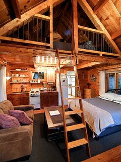 There is a loft with a drop down ladder so the cabin can accommodate four people