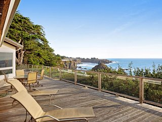 Oceanfront home with private hot tub, views, and close beach access!