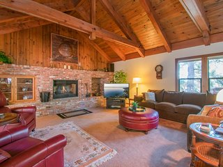 Woodland home w/ indoor hot tub & fireplace - minutes to lake beach, 3 dogs OK!