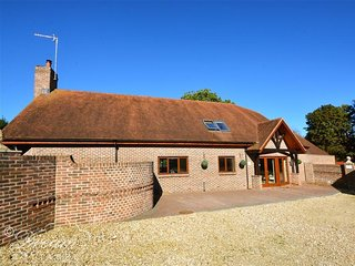 BAYTREE LODGE, wood-burning stove, five bedrooms, games room, swimming pool in