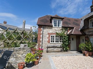 FORGE COTTAGE, sleeps 5, village location, parking, garden, close to beach, West