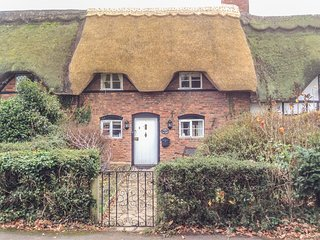 ACORN COTTAGE, mid-terrace, thatched cottage, ideal for a couple, in