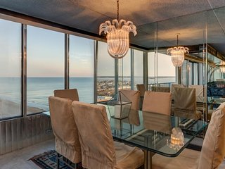 Penthouse w/ ocean view plus amenities like a shared pool, game room, & gym