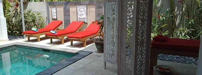 Pool lounges and massage table