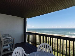 Oceanfront condo with updated kitchen, expansive deck, and pool access