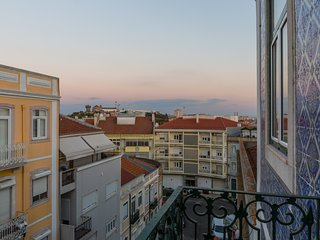 A room in a home with a view over Lisbon's beauty