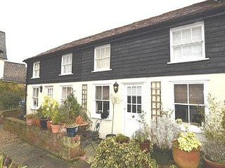 A cottage situated in a Grade II listed building renovated from a former public