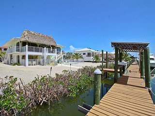 Canal-Front Retreat w/ Pool, Water Views & Private Dock for 2 Boats