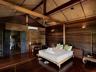 Luxury loft in traditional wooden stilted longhouse