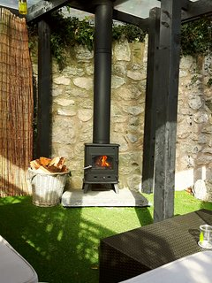 Covered lounge  outdoors, snuggle up in front of log burner