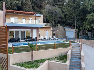 On the right side of the villa is built BBQ, outdoor shower.