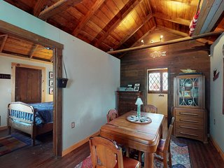 Cozy, lakefront cabin w/ a furnished deck, beach access, & an outdoor shower