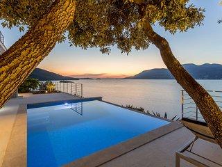 Beachfront Villa Poseidon with Heated Pool