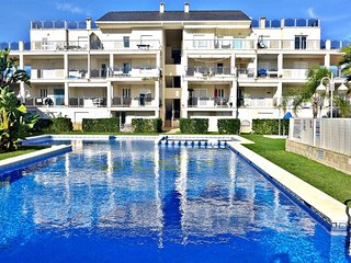 Spacious apartment a short walk away (455 m) from the 'Playa de Rabdells' in Oli