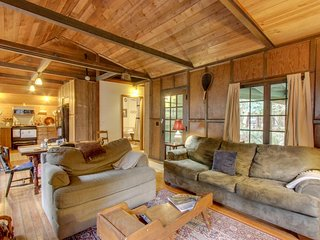 Dog-friendly, 1930s cabin w/ a wraparound deck, private hot tub, & wood stove