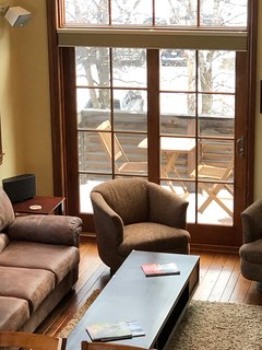 Surround sound speakers, living room deck over river, all electric blinds (on living room level)